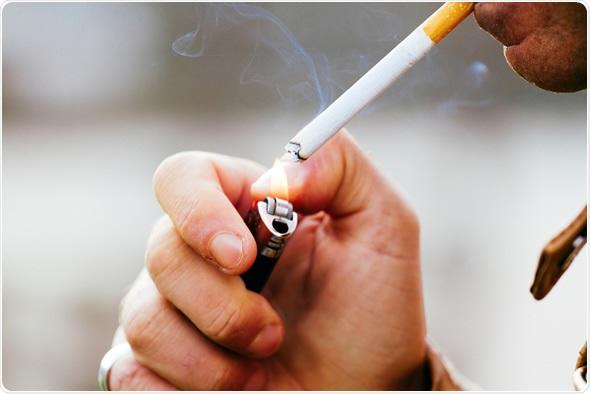 Smoker lighting a cigarette