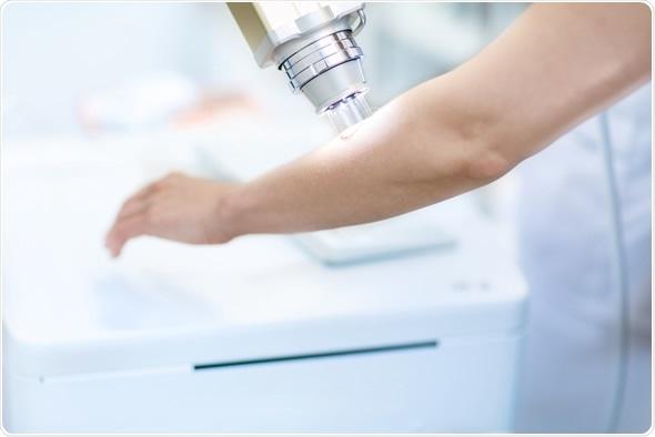 Professional skin examination in dermatology clinic. Image Copyright: SewerynCieslik / Shutterstock