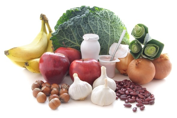 Probiotic (or prebiotic) rich foods including pulses, nuts, fruit and milk products, good for immunity and the gut. Image Copyright: Pixelbliss / Shutterstock