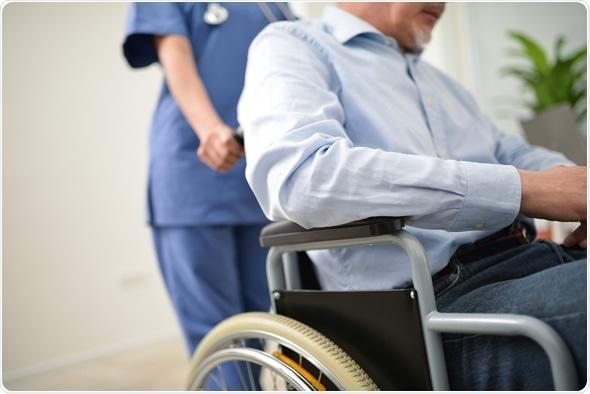 Nurse pushing an injured patient on a wheelchair - Image Copyright: Minerva Studio / Shutterstock