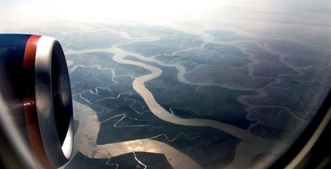 The Ganges Delta, as seen from an airplane. With a surface area of around 140 km2, it is the largest river delta in the world. The arsenic-rich sediments of the Ganges Delta are the source of the high arsenic concentrations in Bangladesh