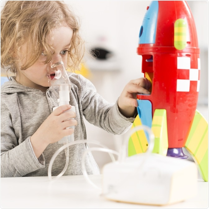 Child with cystic fibrosis using nebulizer. Image Credit: Photographee.eu / Shutterstock