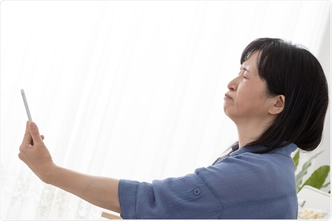 Presbyopia. Image Credit: Aijiro / Shutterstock