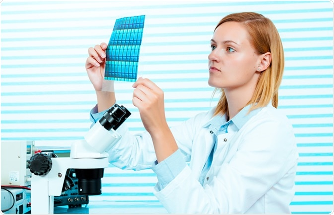 Silicon wafers production, photolithography. Image Credit: Science Photo / Shutterstock