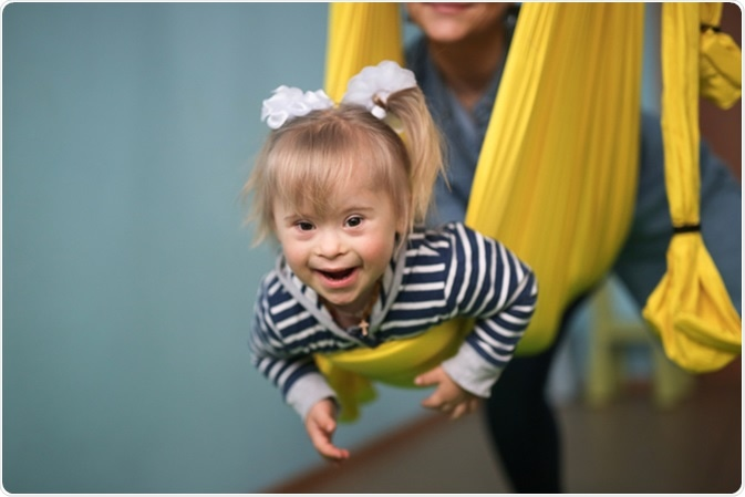 Mom with child Down syndrome playing. Image Credit: Natalia Lebedinskaia / Shutterstock