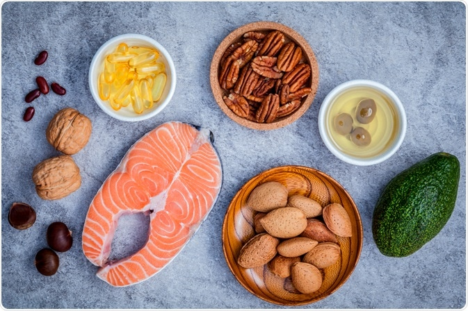 High fat healthy foods - fish, vitamins, nuts and avocado - photo taken by Kerdkanno
