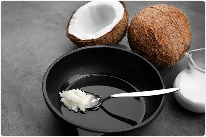 Coconut oil on frying pan. Image Credit: Africa Studio / Shutterstock