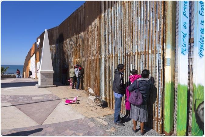 Border wall in Playas de Tijuana. Image Credit: Chad Zuber / Shutterstock