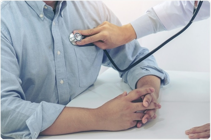 Doctor listening to the heartbeat of a patient with COPD.