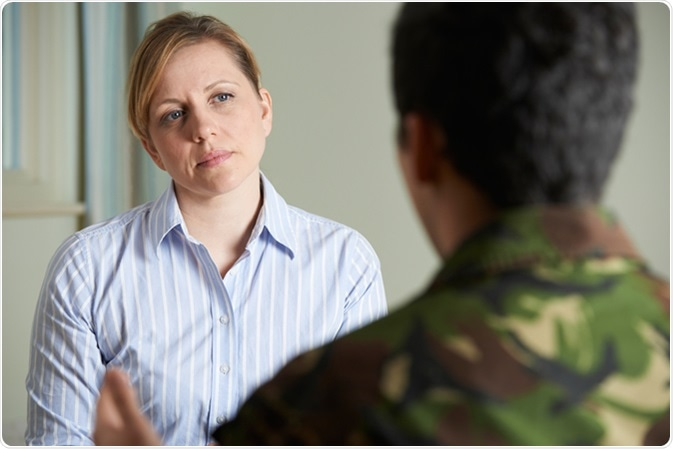 Soldier talking to counselor. Image Credit: SpeedKingz / Shutterstock