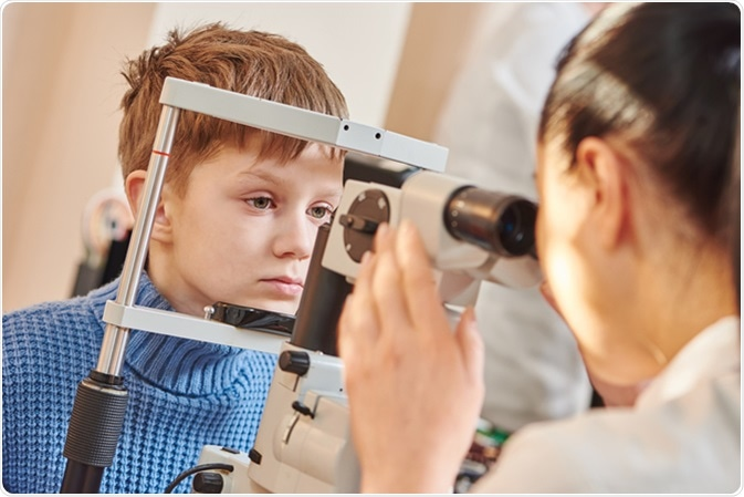 Young male patient in eye ophthalmological clinic. Image Credit: Dmitry Kalinovsky / Shutterstock