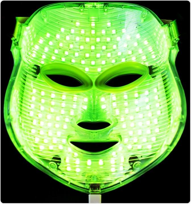 Light rejuvenating mask for facial skin therapy. Image Credit: Victoria Shapiro / Shutterstock