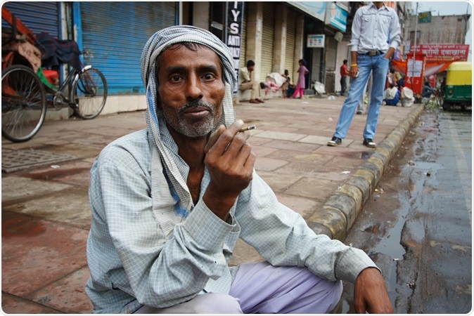 DELHI, INDIA - An unidentified man smokes a traditional