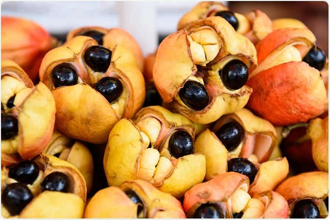 A pile of raw ackees in their pods; Blighia sapida. Image Credit: Sevenstock Studio / Shutterstock