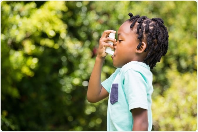 Boy using an asthma inhaler. Image Credit: Wavebreakmedia / Shutterstock