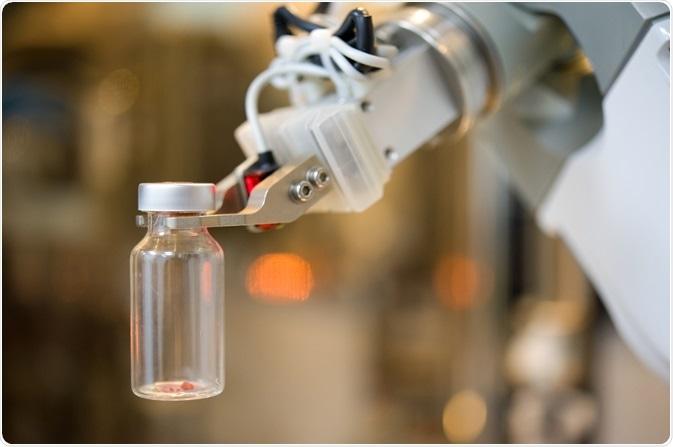 laboratory robot handling a sample