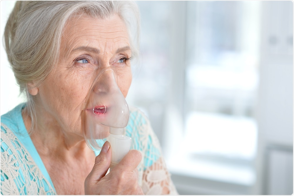 Woman with oxygen mask on