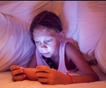 Children should not be allowed smartphones in bed or at mealtimes, say experts