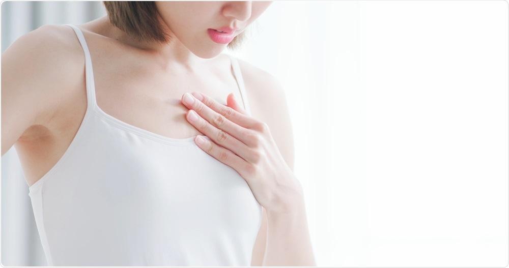 Woman with unpleasant chest ache