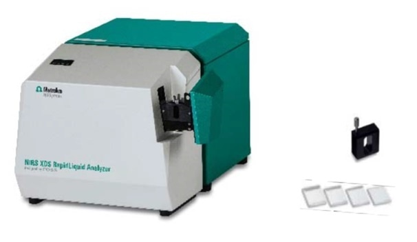 The Metrohm NIRS XDS RapidLiquid Analyzer with used cuvettes and cuvette spacer.