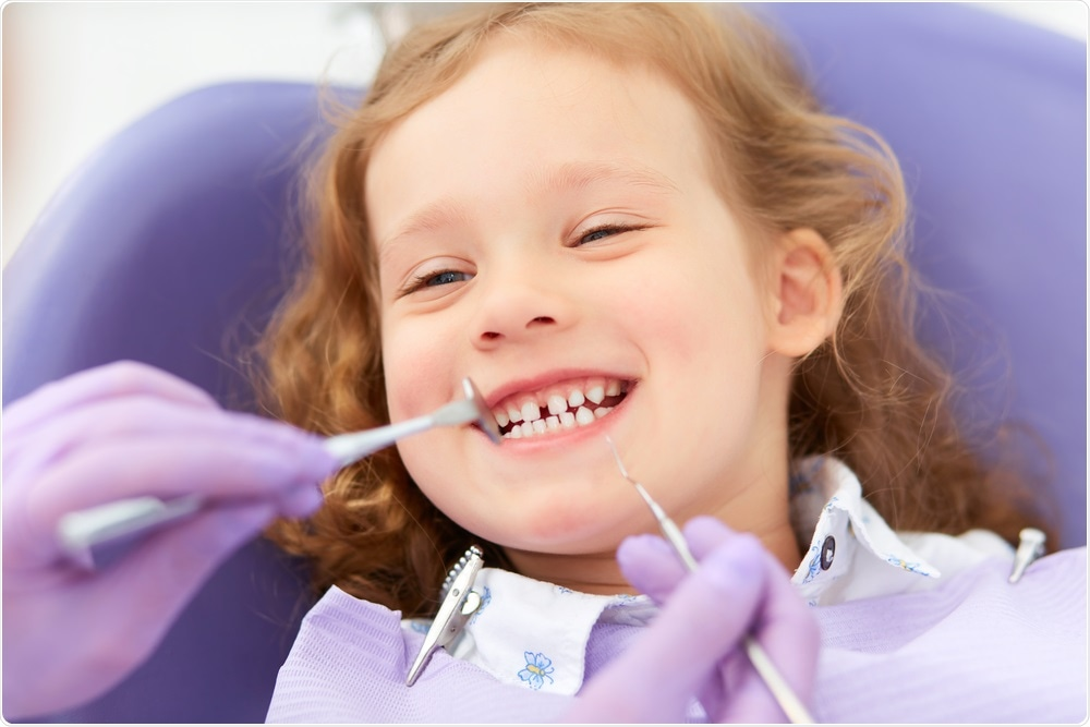 Child at the dentist with tooth decay