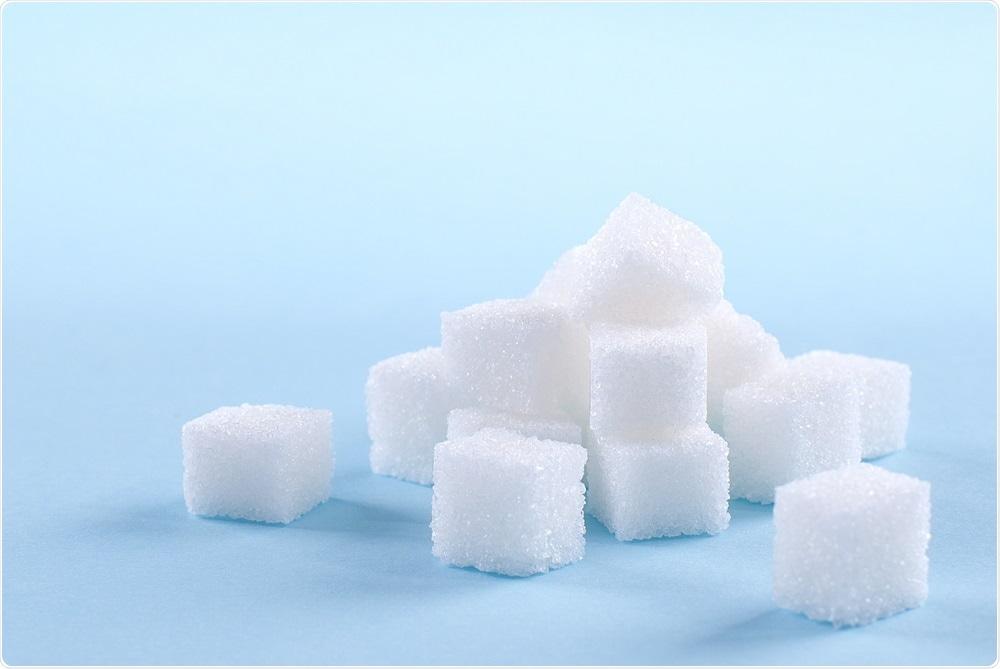Sugar cubes on blue background