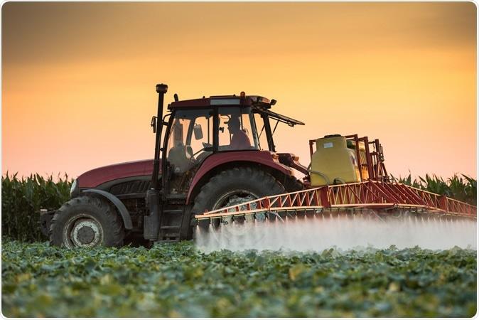 Tractor spraying pesticides. Image Credit: Fotokostic / Shutterstock