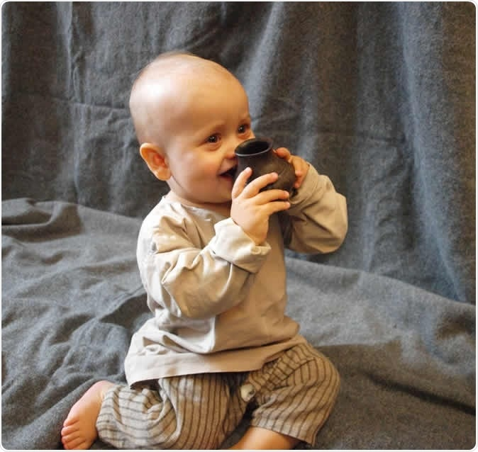 A modern-day baby testing a replica of one of the ancient bottles. Helena Seidl da Fonseca, Credit: Julie Dunne, University of Bristol