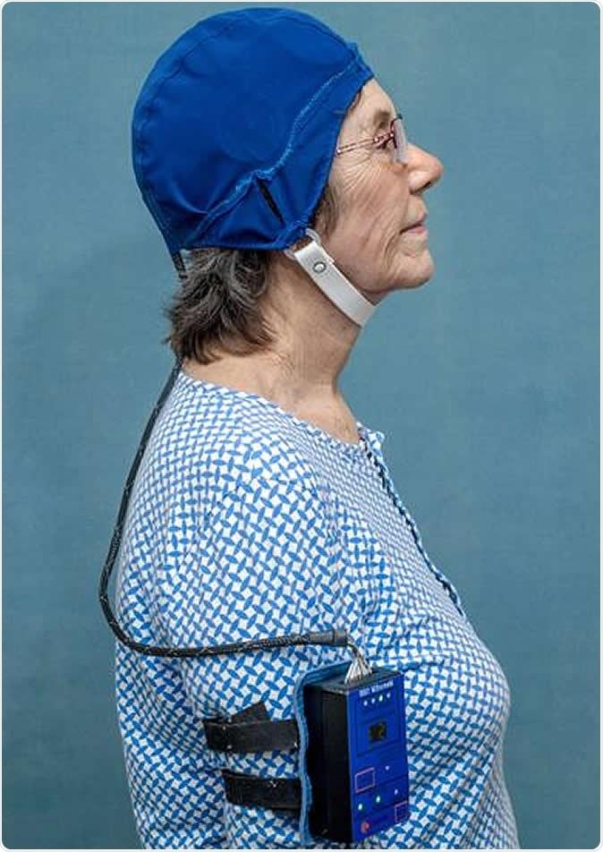 Patient wearing MemorEM. Credit: NeuroEM Therapeutics, Inc.