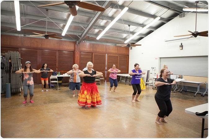 Hula dance class with instructor, Hula teacher (kuma hula) Ka'olu Luning, Ke Ola Mamo Health Systems Medical Clinic, Honolulu, HI. Copyright Nicasello Photography
