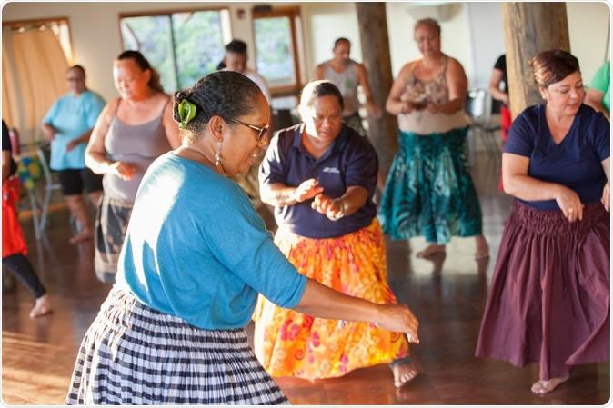 Hula instructor leading class, Kumu hula (Hula teacher) Kamanaʻo Manoa-Hyde leading her class. Waiʻanae Coast Comprehensive Health Center. Copyright Nicasello Photography