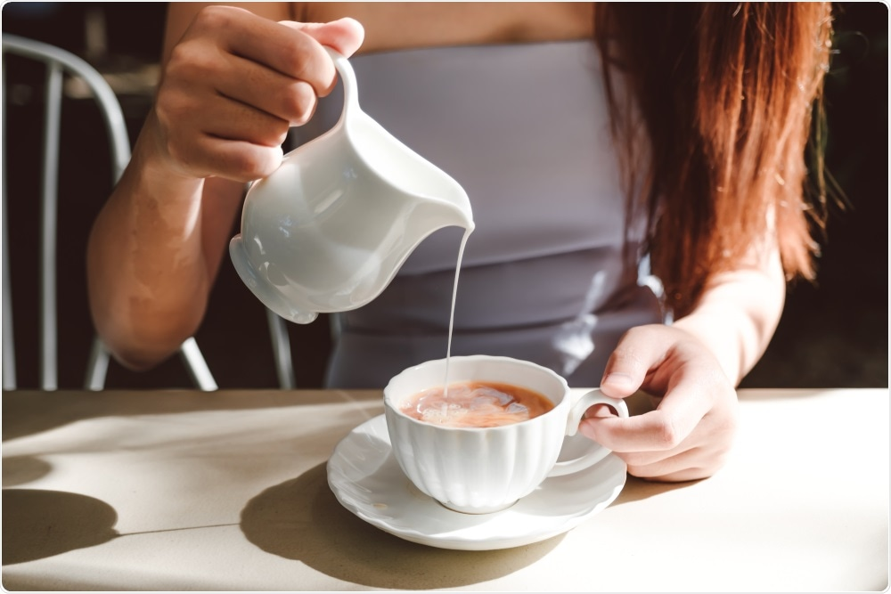 Woman stirring cup of tea