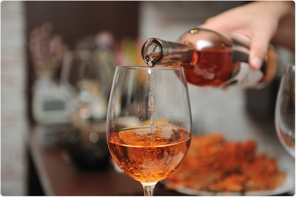 Alcohol - wine is poured into glass