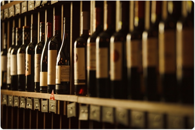 Wine bottles lined up in cellar