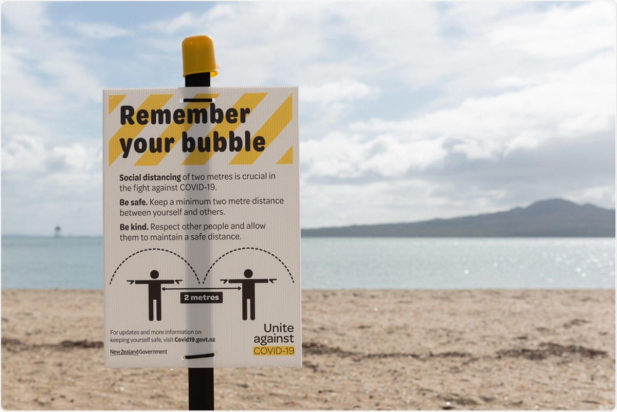 Mission Bay, Auckland / New Zealand - April 16 2020: Warning sign on Mission Bay beach reminding people to maintain 2 metres of social distancing during the coronavirus/covid-19 pandemic lockdown. Image Credit: Steve Todd / Shutterstock