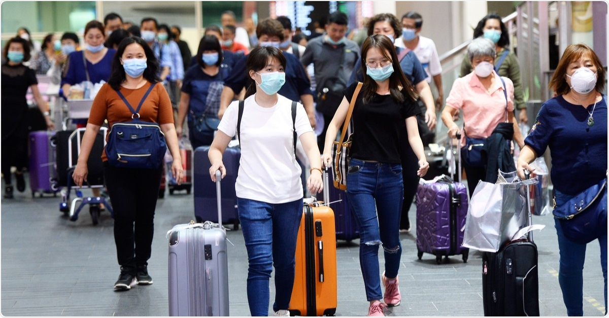 Travelers wear masks at Kuala Lumpur International Airport to prevent infection from coronavirus outbreak. February, 2020. Image Credit: Naufal Zaquan / Shutterstock