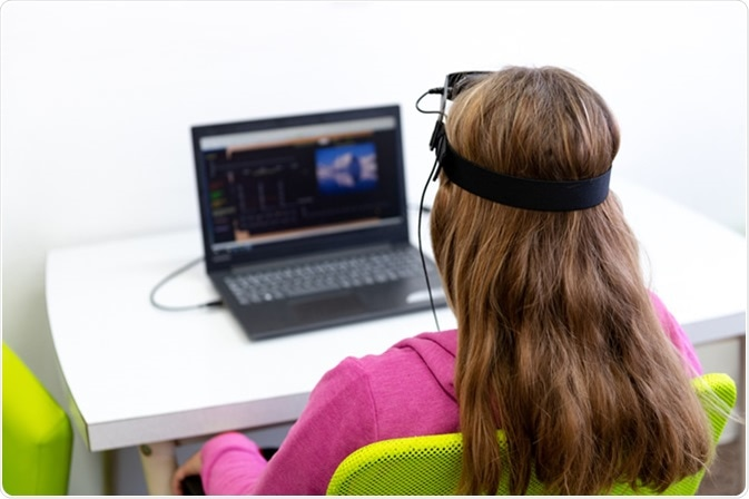 Young teenage girl during EEG neurofeedback session. Image Credit: ABO PHOTOGRAPHY / Shutterstock