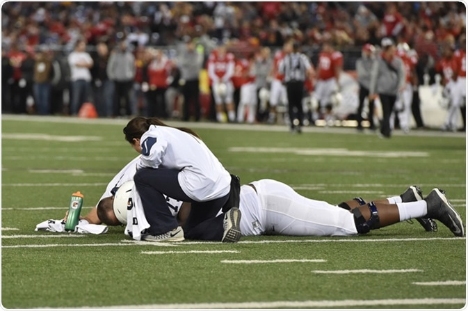 BALTIMORE - OCTOBER 24: Trainers tends to an injured Nittany Lion player during the NCAA football game against Maryland October 24, 2015 in Baltimore. Image Credit: Aspen Photo / Shutterstock