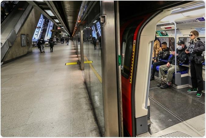 People wearing face masks taking Jubilee Line underground train. Image Credit: Vudi Xhymshiti / Shutterstock