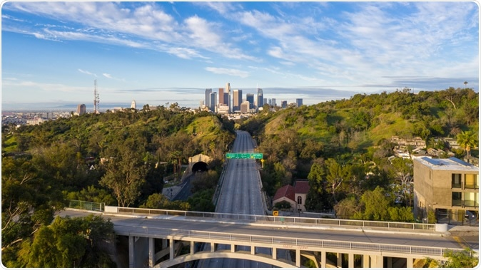 Aerial view of empty freeway streets with no people in downtown Los Angeles California as result of coronavirus pandemic or COVID-19 virus outbreak and lockdown. Image Credit: Hyperlapse Media / Shutterstock