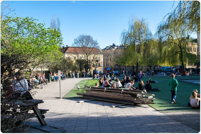 Stockholm / Sweden - April 21, 2020: Swedes outdoors enjoying spring weather during coronavirus pandemic, at a popular square called