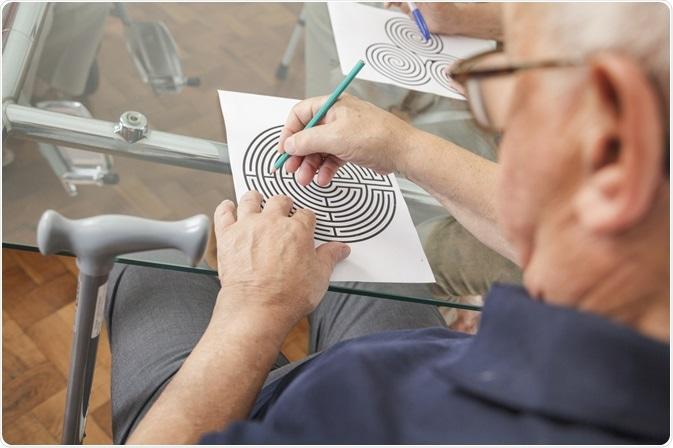 Elderly Man doing Cognitive Mind Puzzle
