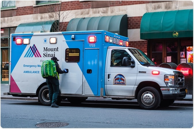NEW YORK - APRIL 01, 2020: An EMS worker outside of a Mount Sinai ambulance in Tribeca, New York City during the COVID-19 pandemic. Image Credit: Jennifer M. Mason / Shutterstock