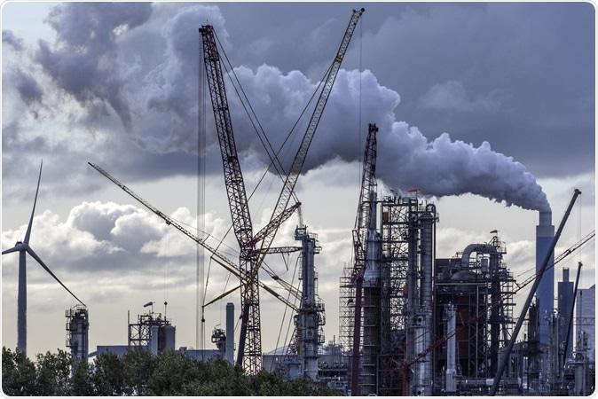 Industrial Pollution - an industrial skyline in Rotterdam - Netherlands. Image Credit: Steve Allen / Shutterstock
