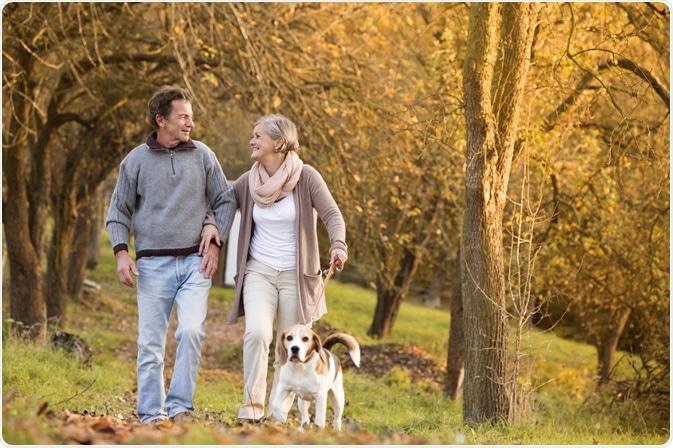 Elderly Couple Dog Walking