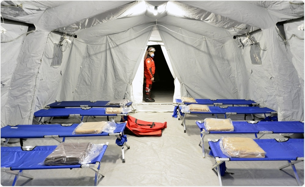 LOMBARDIA, ITALY - FEBRUARY 26, 2020: Hospital field tent for coronavirus. Image Credit: faboi / Shutterstock
