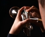 Schlieren techniques demonstrate patterns of exhaled air spread from wind instruments and singers
