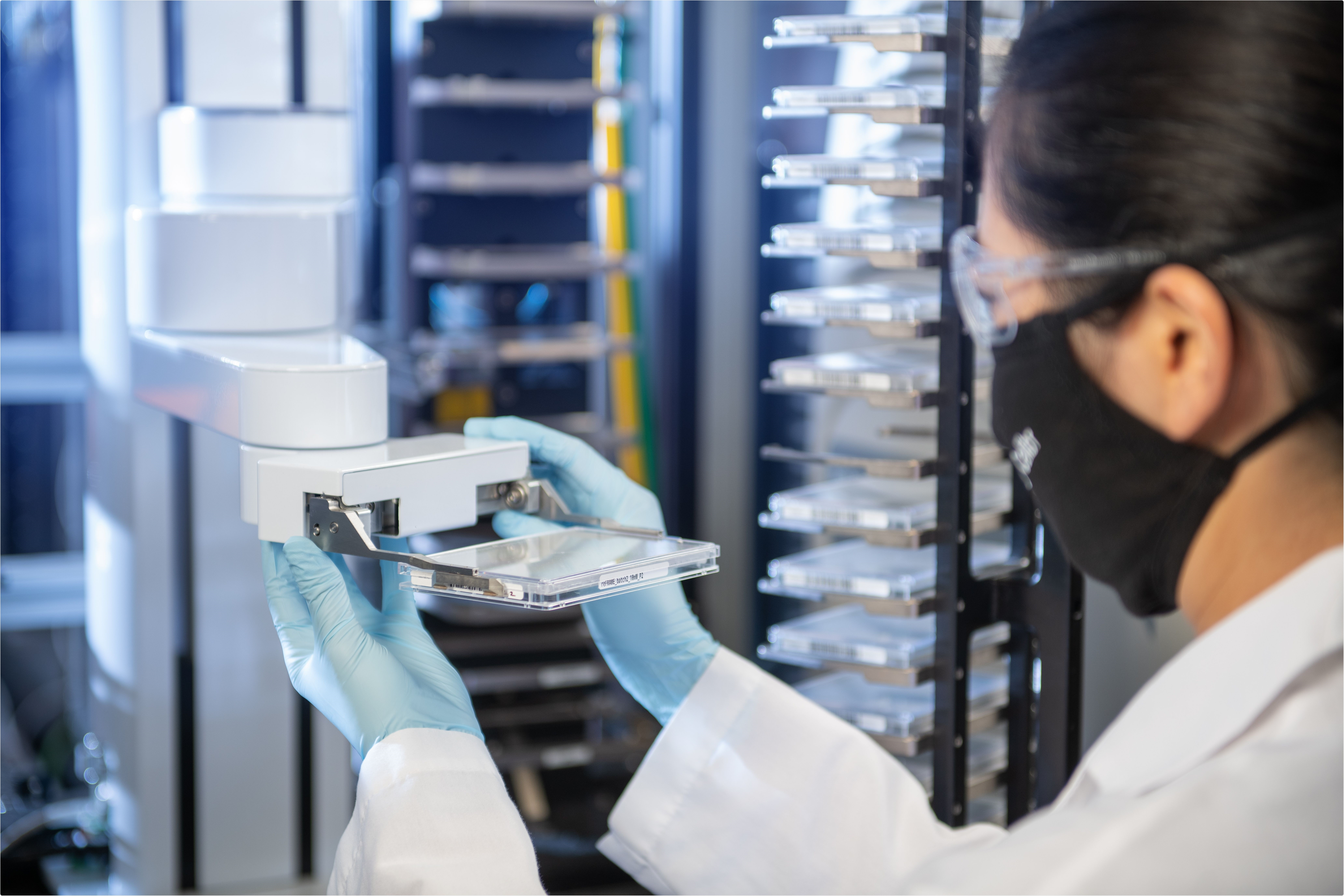 A researcher at Calibr, the drug discovery division of Scripps Research, working in the high-throughput screening facility used to identify potential COVID-19 therapies.