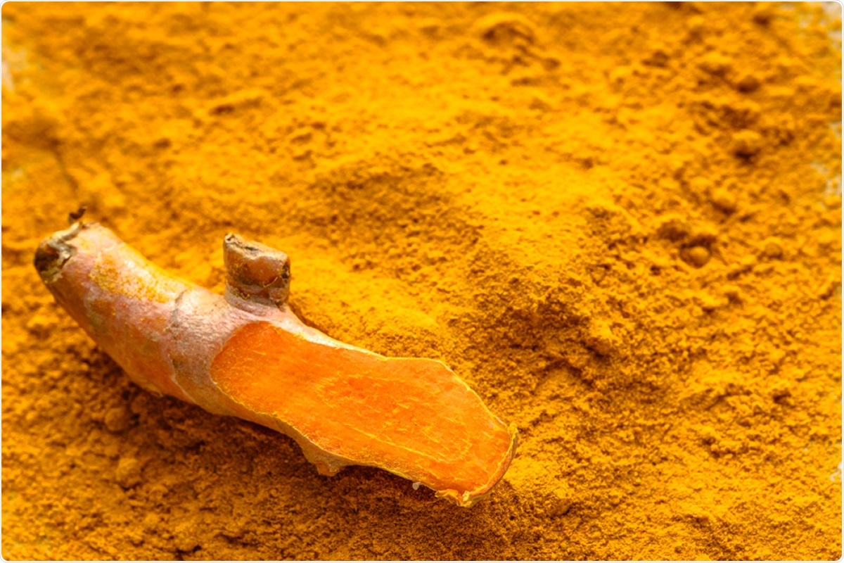 Fresh root and turmeric powder, Curcumin, is the active ingredient in turmeric. Image Credit: Alicja Neumiler / Shutterstock