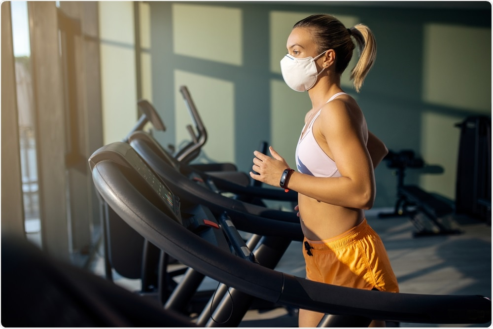 Woman wearing mask and exercising